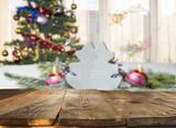 christmas table background with christmas tree out of focus - 180541506