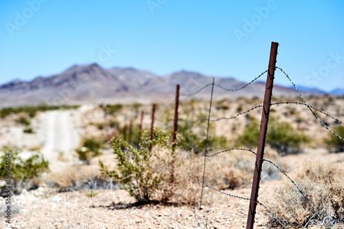 Fotobehang Pool Barb wire fence in desert