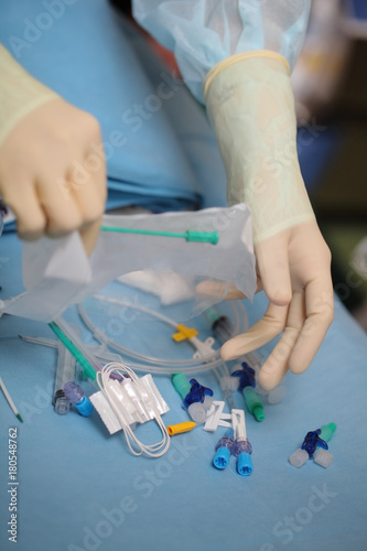 Medical worker opened the pack of catheterization tools during preparation to narcosis before surgery