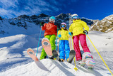 Happy family enjoying winter vacations in mountains. Playing with snow, Sun in high mountains. Winter holidays. - 180556166