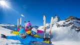 Happy family enjoying winter vacations in mountains . Ski, Sun, Snow and fun. - 180557334