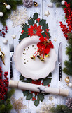 Christmas holiday dinner background; empty dish, cutlery and Christmas tree decoration - 180573539
