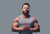 Bearded bodybuilder dressed in a tank top. - 180576389