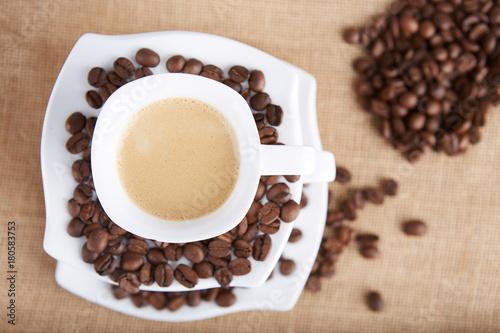 Papiers peints Café en grains Cup of coffee set on a jute bag.