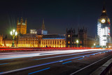 Night scene with light trails on the Westminster bridge. Big Ben and House of Parliament in London, The United Kingdom of Great Britain.