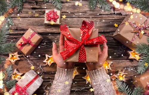 Top view of woman hands with gift box. Plakát