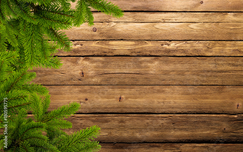 frame of fir branches on wood
