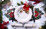 Christmas holiday dinner background; empty dish, cutlery and Christmas tree decoration - 180610997