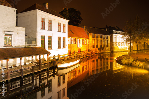 Tuinposter Brugge Bruges by night. Calm Dijver canal with boat in the dock. Belgium.