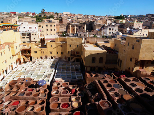 Papiers peints Maroc Coloration of leather in a ancient traditional leather tanneries tannery, Fes, Morocco, Africa