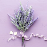 Lavender flower on purple wooden background.