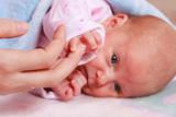 Little newborn baby lying in blanket