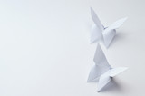 origami butterflies on white background