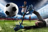 Fototapeta Sport - Goalkeeper kicks the ball in the stadium © alphaspirit
