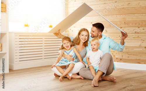 concept housing a young family. mother father and children in  new home - 180664932