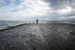 Woman standing at end of boat ramp. Point Holmes ~ Vancouver Island, British Columbia, Canada