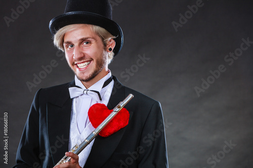 Fotobehang Muziek Male flutist with flute and heart. Love melody