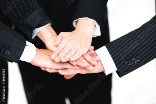 Group of people joining their hands. Teamwork concept. Poster