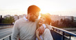 Romantic couple dating in sunset