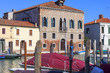 Murano island, view on the canal in the middle of the city, colorful houses, Venice, Italy.