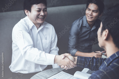 Sticker businessman handshaking process after successful deal of business meeting,Close up image handshake of business partnership