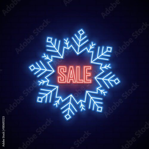Neon signboard in shape snowflake. Bright neon banner of sale.
