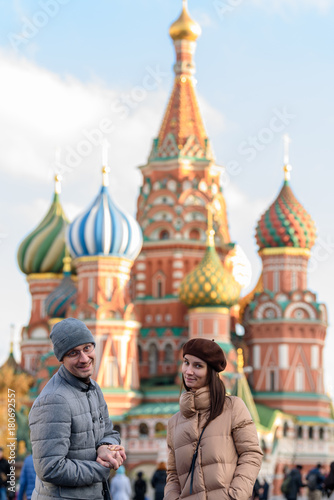 Fotobehang Moskou Stylish couple on the red square on the background of St. Basil's Cathedral