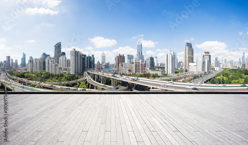 Fotobehang Shanghai empty brick floor with cityscape of modern city