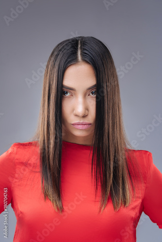 Aluminium Kapsalon Spoilt person. Young beautiful selfish woman standing against the blue background and frowning while being offended