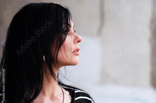 Plakat Beautiful young woman in a striped T-shirt
