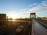 Sun rising at the Brooklyn Bridge, Manhattan, New York
