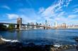 Lower Manhattan and Brooklyn bridge seen from Brooklyn Bridge park in Brooklyn, New York.