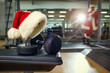 Santa's hat in the gym. Concept of sports on Christmas and New Year.