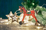 Christmas card with firtree balls and red wooden horse white - 180738147