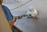 Laborer performing and polishing sand and cement screed floor. Sand and cement floor screed. - 180741919