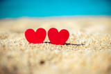 romantic symbol of two hearts on the beach  - 180742723