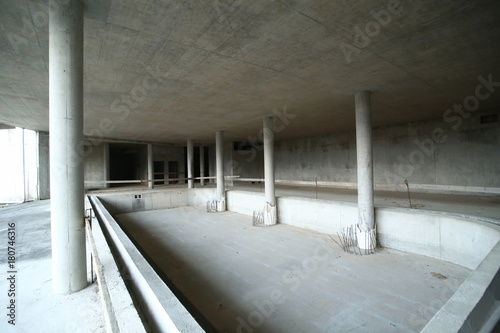 Abandoned construction site with swimming pool base