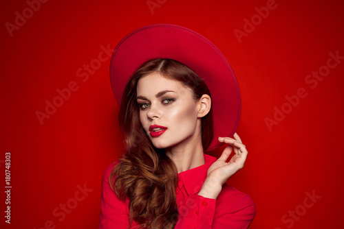 beautiful woman with hat, brown hair, hand at face