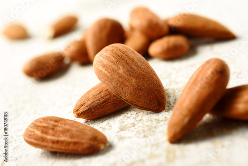Fridge magnet natural almonds on white table