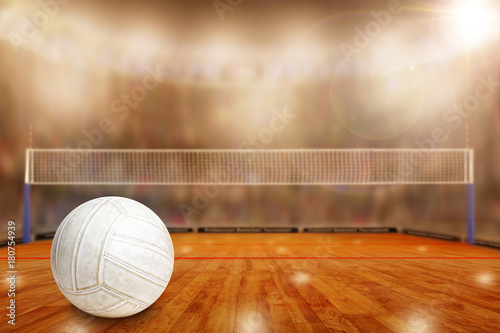Fictitious volleyball arena with ball on court and copy Space. Focus on foreground with special lighting and lens flare effect on background.
