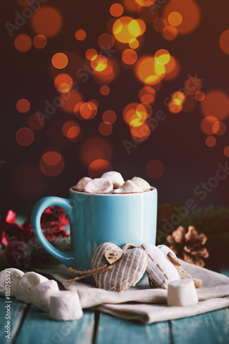 Foto op Canvas Chocolade Blue mug filled with hot chocolate with marshmallow candies. Lights on background