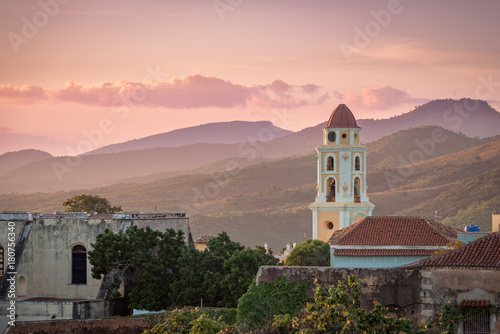 Deurstickers Havana Sunset touching the church and mountains at Trinidad, Cuba