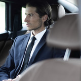 businessman sitting in a comfortable car