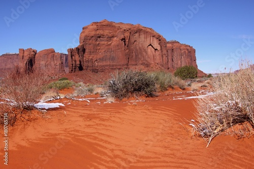 Foto op Aluminium Koraal Red sand in the Monument Valley