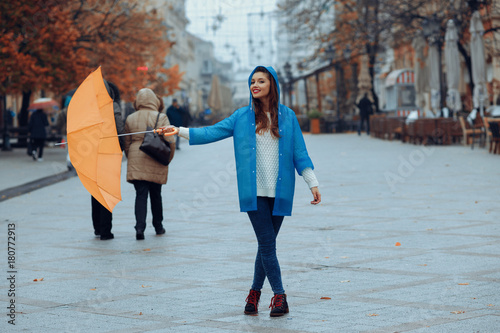 Juliste Young happy woman on a rainy day