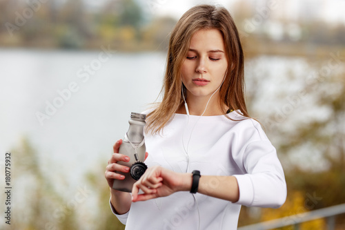 Fototapeta Woman checking fitness and health tracking wearable device.