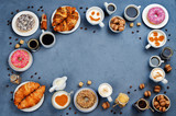 Stone background with different types of coffee and desserts to them - 180779175