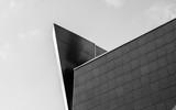 Modern dark building with geometric shape, pyramid. Monochrome. - 180779961