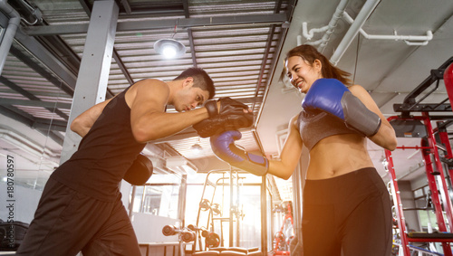 Poster Fitness couple asian doing exercises the boxing. Concept of healthy lifestyle in the gym.