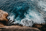 Aerial view to ocean waves and rock coast - 180787149